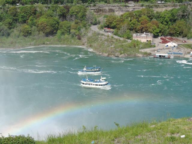 A rainbow greets boats at Niagara Falls, New York.