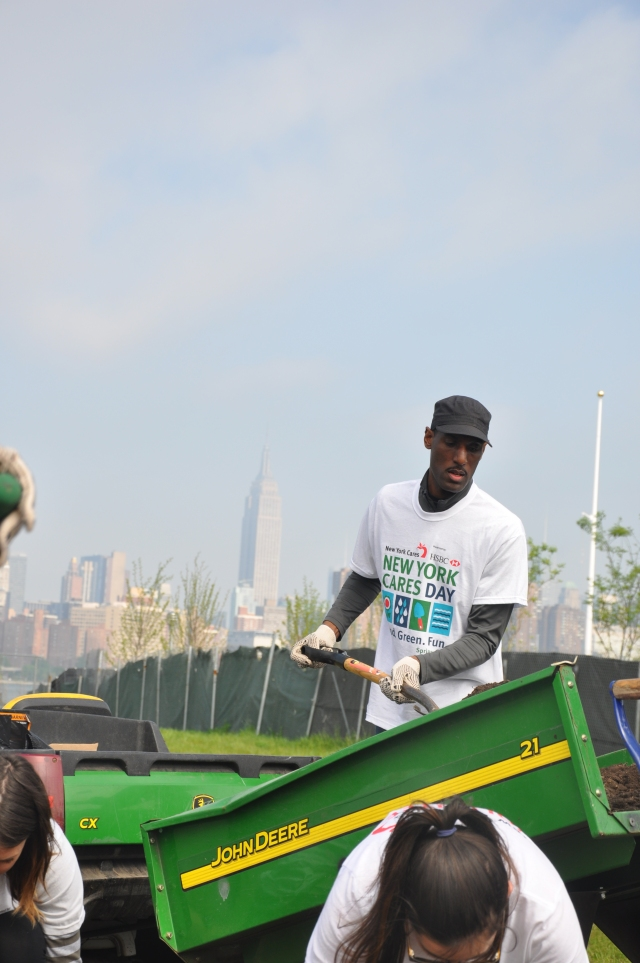Every spring, thousands of New Yorkers participate in New York Cares Day Spring. Everyone descends on parks around the city to plant, garden, and spruce up parks. This shot was taken in East River park in Brooklyn.