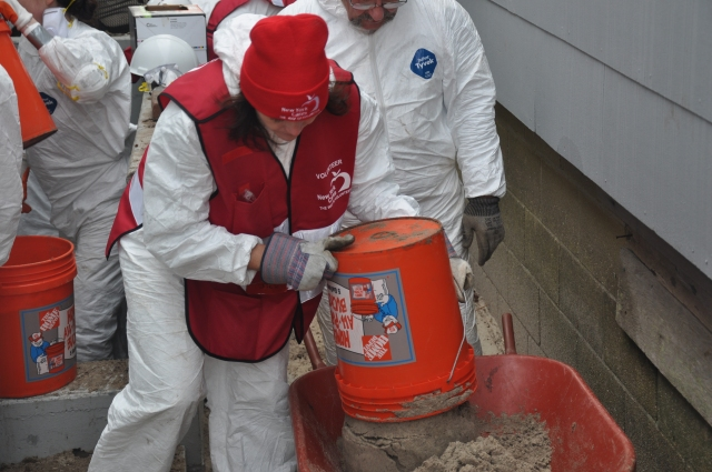 When Hurricane Sandy hit New York, New York Cares staff and volunteers sprang into action. Here, a volunteer cleans out sand from the home of a Rockaways resident who's basement had flooded.